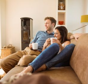 Couple enjoying the warmth of a combi boiler at home, warm and cozy