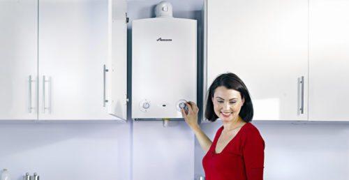 Woman using condensing boiler