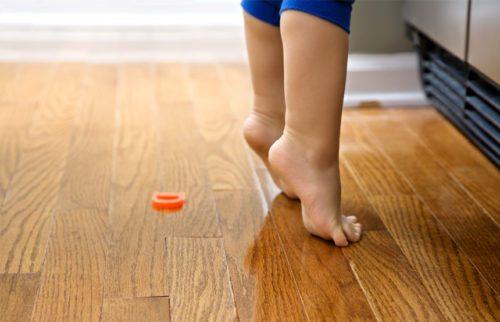 Toddler feet on warm floor
