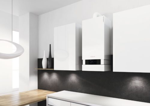 Boiler in modern kitchen; central heating installation cost