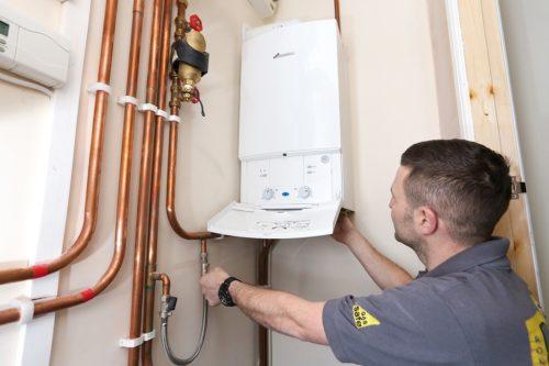 Engineer installing a boiler; boiler installation cost