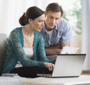 Couple lowering their central heating installation cost by researching online