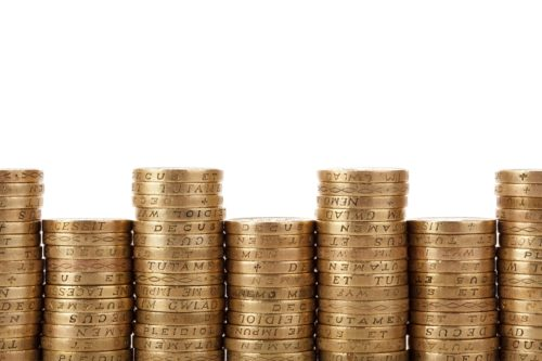 Stacks of coins; combi boiler prices
