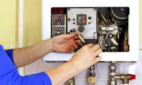 Asking a heating engineer to check on your boiler as part of boiler care