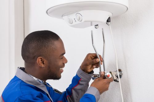 Engineer taking care of boiler; boiler service cost